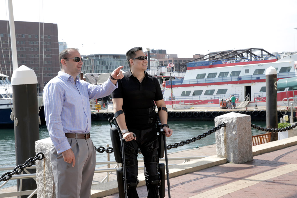 US veteran Robert Woo, paralyzed in a freak construction accident, shows off the ReWalk 6.0 version of the Israeli-made exoskeleton system that has given him a second chance to walk again. Photo by ReWalk