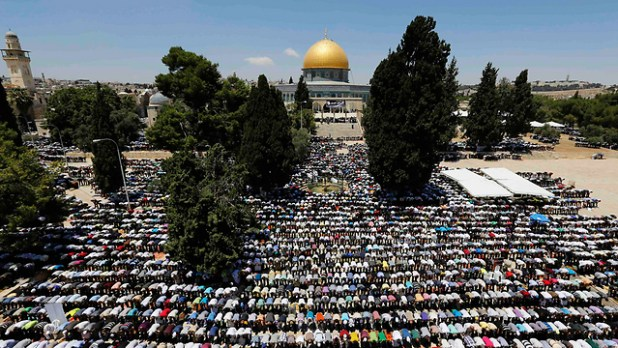 Muslims praying at foot of Temple Mount - Jews are forbidden to pray.