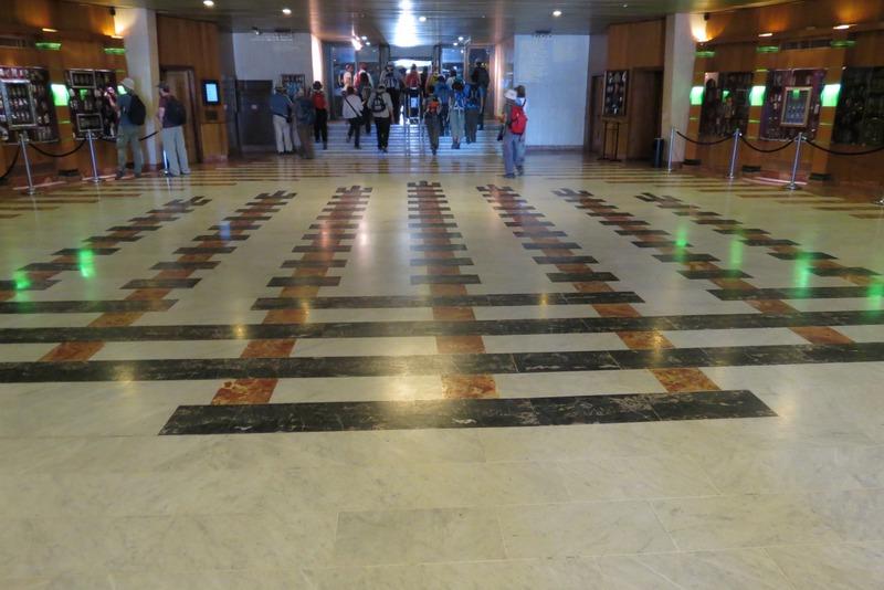 Menorah floor with Rosenbaum Mezuzah Collection on walls of Entrance
