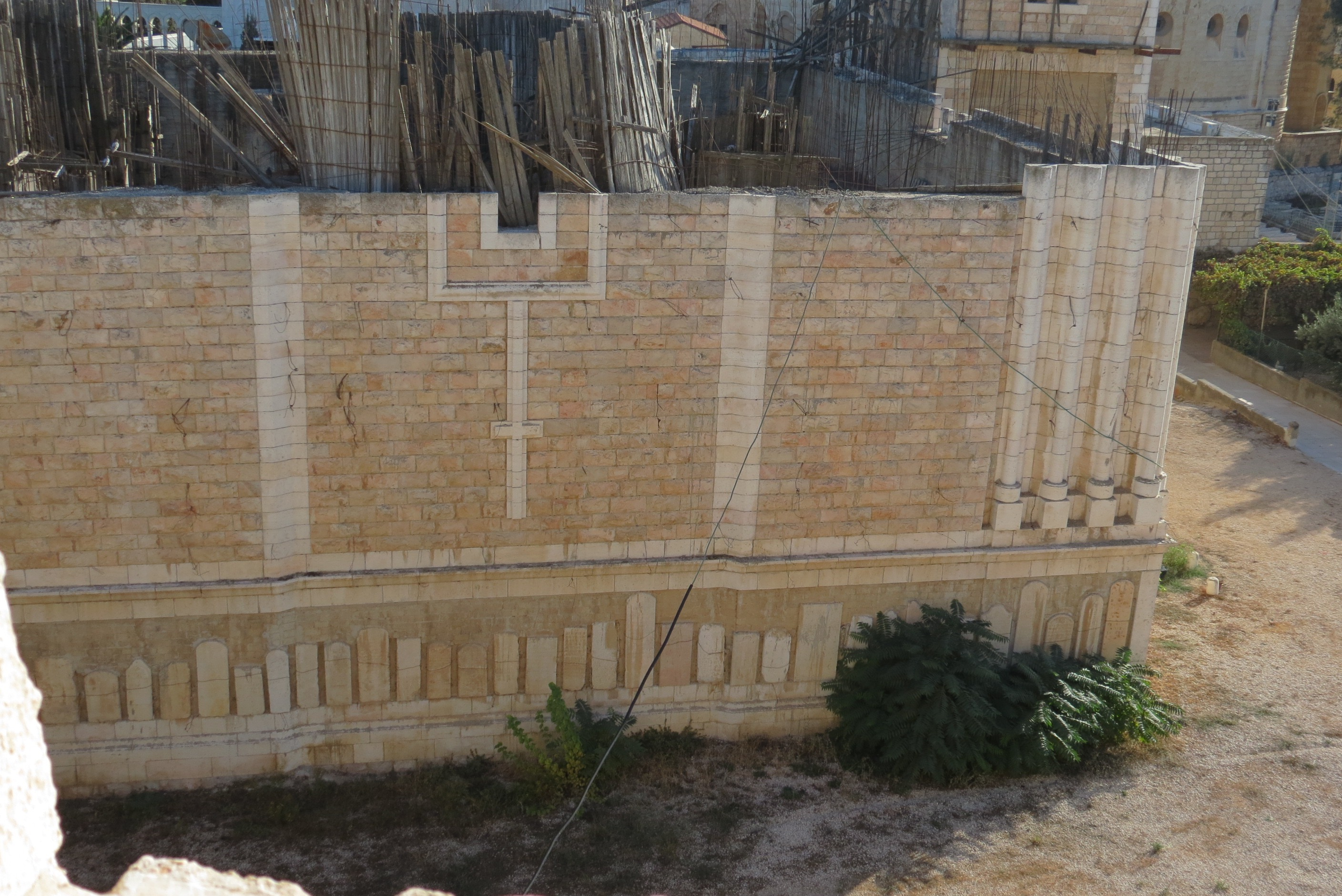 Unfinished Church by Christian Cemetery on Mount Zion. Note grave stones on wall.