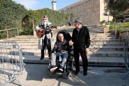 man in wheelchair cannot hope to climb steps into the Cave of the Patriarchs