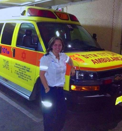 Sabina Tabashi and a MADA ambulance