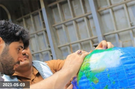 inspecting world globe