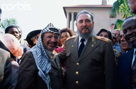 10 Jun 1994, Johannesburg, South Africa --- PLO leader Yasser Arafat and Cuban dictator Fidel Castro at the inauguration ceremony for South African president Nelson Mandela. --- Image by © Peter Turnley/Corbis