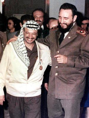 Palestinian leader Yasser Arafat, left, with Fidel Castro.