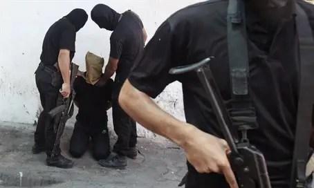 Hamas terrorists prepare to execute a man in Gaza (file)