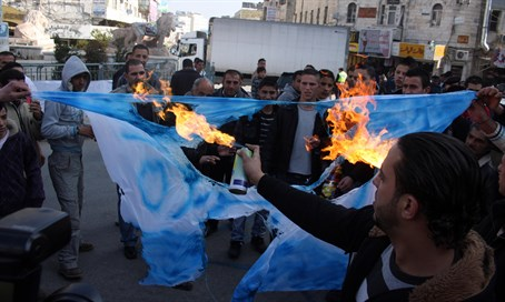 Burning Israeli flag in Ramallah