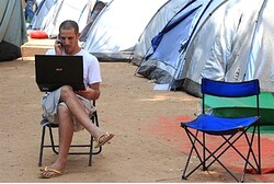 Tent city protester with laptop