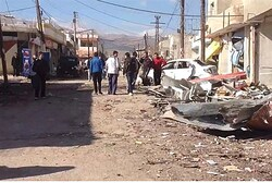 A damaged area is pictured after a car bomb in Qatana, near Damascus