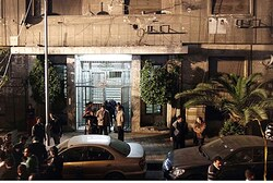 Investigators gather in front of the Israeli embassy in Cairo