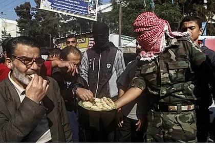 Palestinians hand out candy to celebrate Jerusalem synagogue massacre