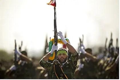 Members of Iran's Basij Force march (file)