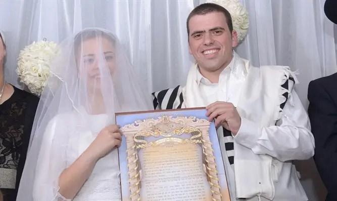 Techiya Litman and Ariel Biegel at their wedding