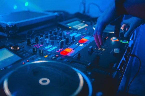 https://www.pexels.com/photo/person-playing-dj-mixer-with-blue-lights-4062563/