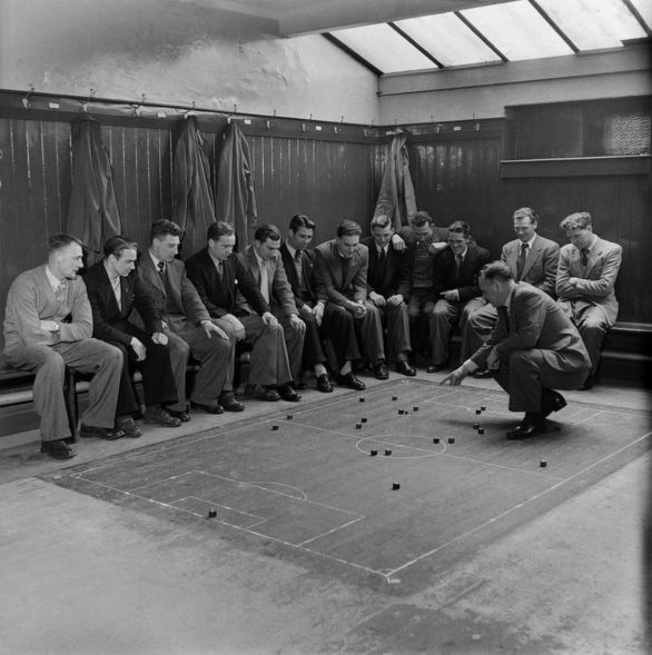Players-of-Southampton-Football-club-are-given-tactical-instruction-by-the-manager-in-the-dressing-room-March-1949-4712660