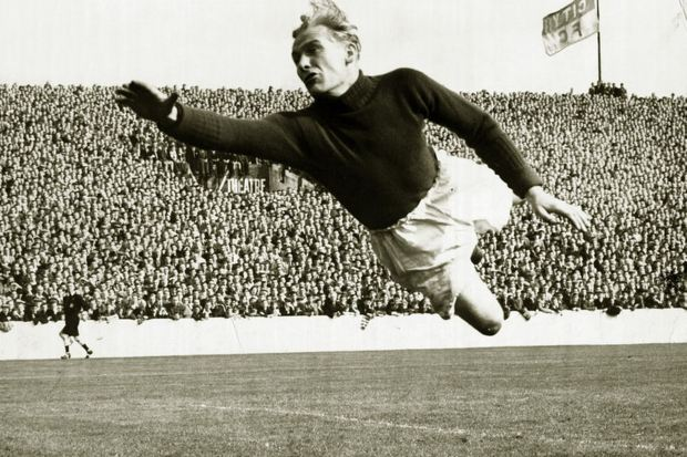 Bert-Trautmann-of-Manchester-City-in-full-flight-as-he-leaps-across-to-cover-a-pile-driver-from-Rye-in-their-First-4712662