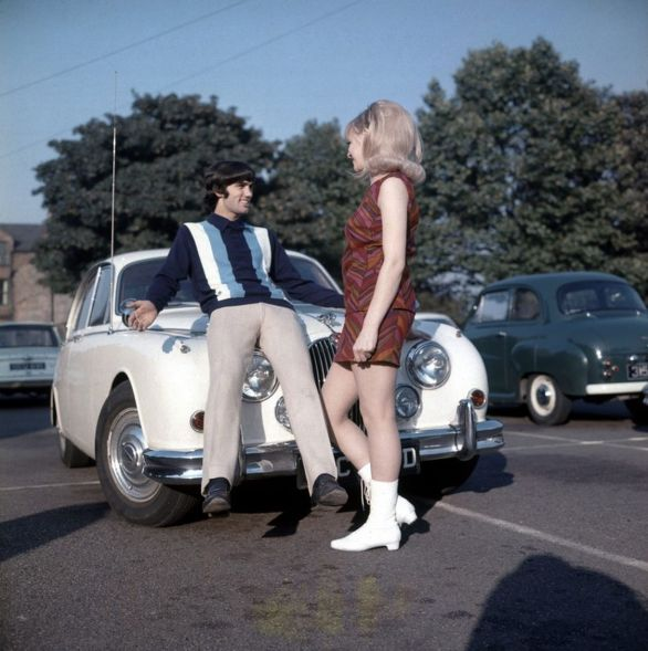 Manchester-United-footballer-George-Best-poses-on-the-bonnet-of-his-car-with-Miss-UK-girlfriend-Jennifer-Lowe--October-4712687