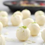 White Chocolate Mojito Truffles are delicate white chocolate shells filled with a luxuriously smooth ganache with fresh lime, mint and a touch of rum.