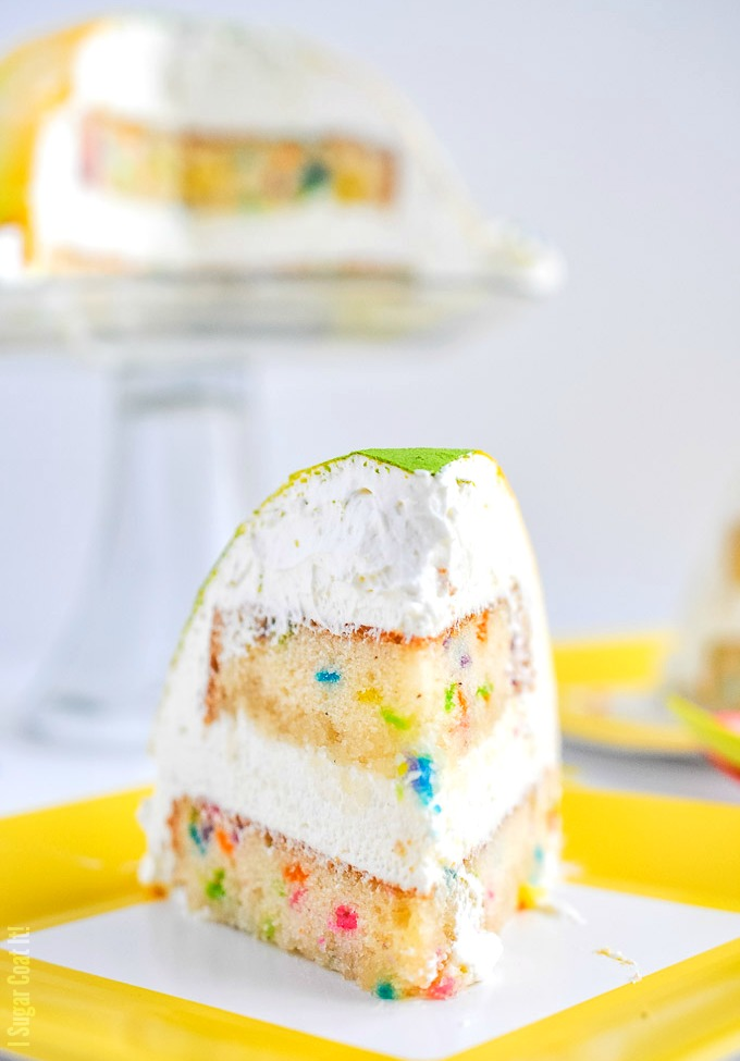 White Chocolate Coconut Mousse Funfetti Cake. Layers of funfetti cake and clouds of white chocolate mousse molded into a fun little cake to welcome spring!