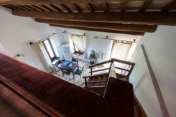 Appartement Giglio | Een van de slaapkamers ligt op de vide