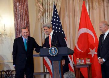 U.S. Secretary of State John Kerry, with U.S. Vice President Joseph Biden, right, delivers remarks in honor of Turkish Prime Minister Recep Tayyip Erdogan at the U.S. Department of State in Washington, D.C., on May 16, 2013. [State Department photo/ Public Domain]