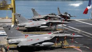 French Rafale aircraft stand on the flight deck of the French aircraft carrier Charles de Gaulle docked at Port Zayed, Abu Dhabi, United Arab Emirates, 26 March 2015. ANSA /ALI HAIDER