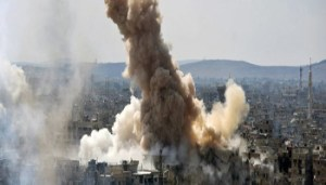 "FILE - In this file photo released on Sunday, April 22, 2018 by the Syrian official news agency SANA, smoke rises after Syrian government airstrikes and shelling hit in Hajar al-Aswad neighborhood held by Islamic State militants, southern Damascus, Syria. Syria's military said Monday, May 21, 2018, that it has liberated the last neighborhoods in southern Damascus held by the Islamic State and has declared the Syrian capital and its surroundings ""completely safe"" and free of any militant presence. (SANA via AP, File)"