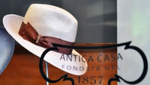 """A picture shows a hat in a shop """"Borsalino"""" on March 17, 2016 in Florence. Hat maker Borsalino will be rescued following a decision by an Italian court, which on March 16, 2016 gave the green light to its industrial relaunch. Judges in the northern city of Alessandria, where the company was founded in 1857, ruled in favour of a rescue plan from Italian businessman Philippe Camperio, co-founder of private equity firm Quest Partners.                  / AFP / Vincenzo PINTO        (Photo credit should read VINCENZO PINTO/AFP/Getty Images)"""