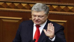 epa07191814 Ukrainian President Petro Poroshenko speaks to lawmakers during extraordinary session of Parliament in Kiev, Ukraine, 26 November 2018. Ukrainian Parliament voted for accepting of the state of martial law in regions close to the Black and Azov seas and along of the border with Russia for a period 30 days. As well, Parliament fixed the date of Presidential elections on the 31 March 2018. Russia has seized three Ukrainian vessels amid their leaving the Kerch Strait on 25 November 2018. The two small-sized 'Berdiansk' and 'Nikopol' armored artillery boats have come under enemy fire and are now dead in the water. The 'Yany Kapu' tugboat has forcibly been stopped. The vessels have been captured by special forces of the Russian Federation, the press service of Ukraine's Navy said on Facebook on Sunday evening. EPA/STEPAN FRANKO