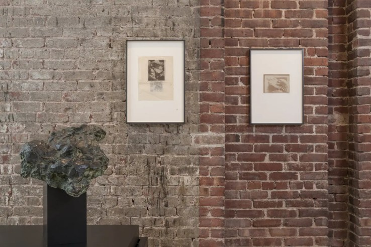 Medardo Rosso, Bambino al seno (Child at the Breast), (bronze, from Museo Medardo Rosso), and related photos on wall. Photo by Walter Smalling, Jr.