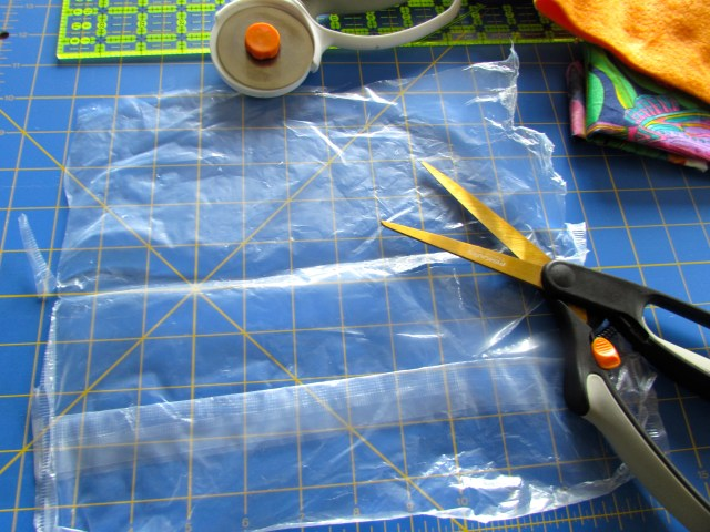 Cutting the plastic for DIY taggie toy. http://www.itchinforsomestitchin.com