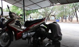 Thai mechanic fixing a bike