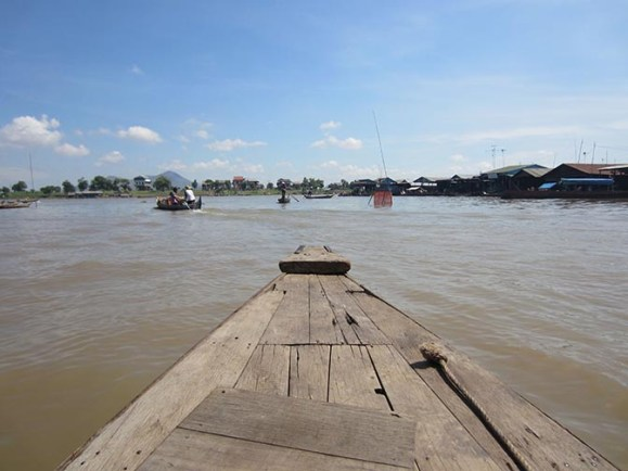 wooden boat on a river in Cambodia