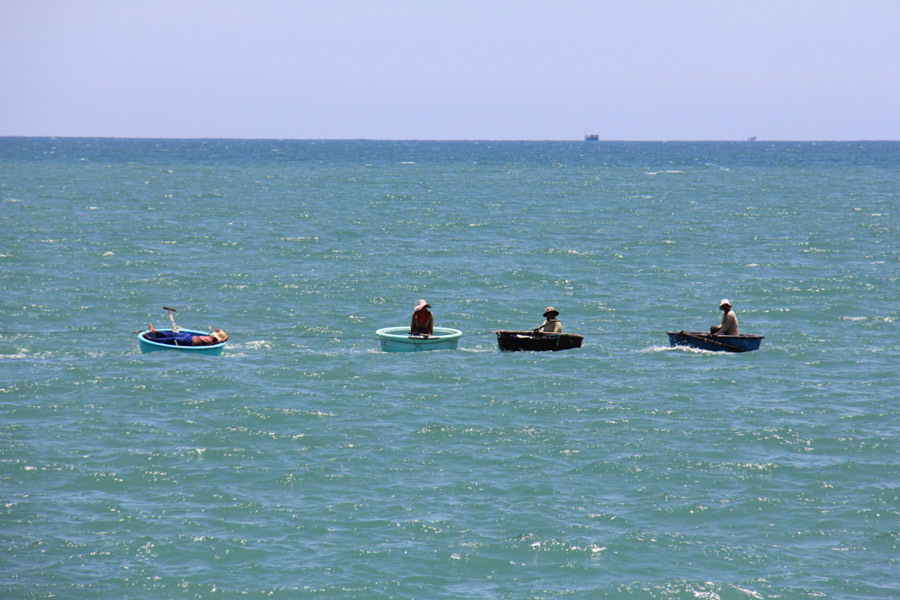 Fishermen in coracles in the South China Sea, Vietnam
