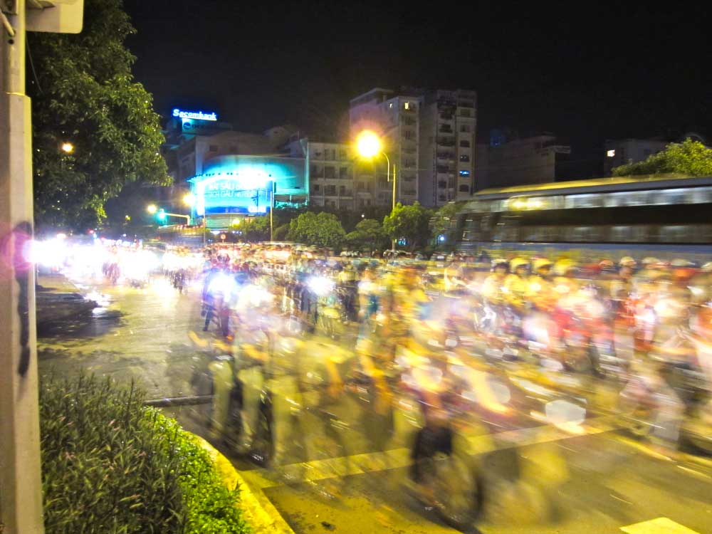 Time lapse photo of motorbikes on a busy street in Saigon, Vietnam