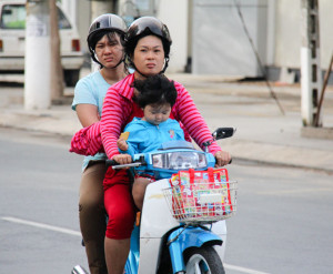 Three people on a scooter in Vietnam