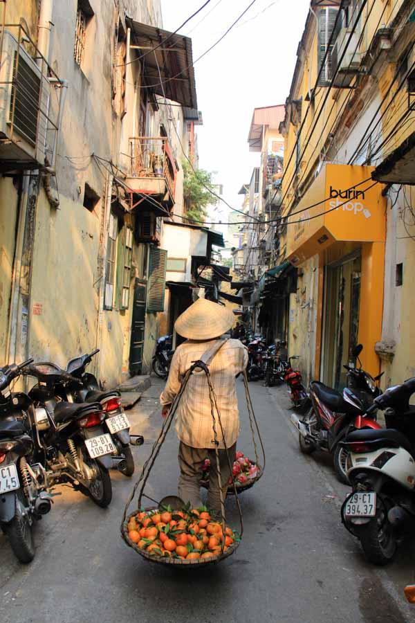 A woman selling fruit in Hanoi, Vietnam