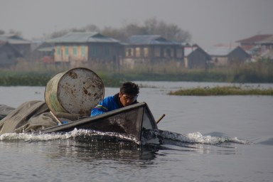 Shipping a barrel across Inle Lake, Myanmar
