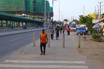 New pedestrian spaces along the corridor transform the streetscape.