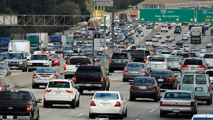 Traffic stacks up on the west- and east-bound lanes of the 210 Foothill Freeway near Los Angeles. The city is actively working to reduce car use with transit and car share programs. (Photo by Kevork Djansezian/Getty Images)