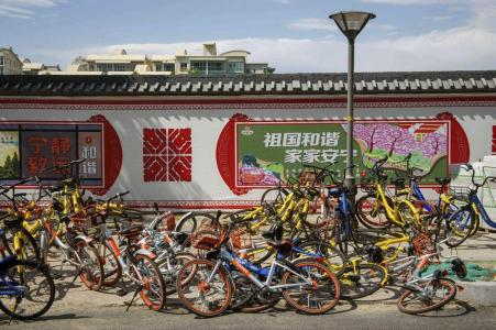 Oversupplies of dockless bikes clutter sidewalks across cities in China.