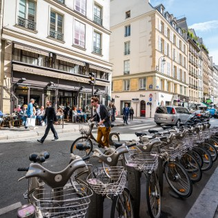 Paris set the standard for bikeshare in major cities with the launching of Velib' more than a decade ago. In 2018, Velib' became Velib' Metropole, with an expansion plan including all new bikes—including some pedal assist e-bikes,—and new stations. The rollout of the new system hasn't quite gone as planned, and the city's recent move to take over the installation of new stations from a private operator signals the importance of Velib' in the city's transport network. Even though dockless bikes are now available in the city, there are currently no formal regulations to manage their operation and some operators have left Paris due to theft and vandalism of their bikes.