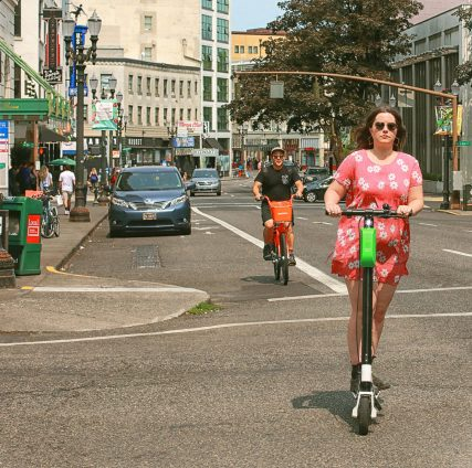 Lime scooter rider in Portland, Oregon. Photo cred: Ian Sane, Flickr