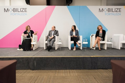 Diane Davis, Roberto Claudio, Lisa Bender, and Angela Anzola de Toro on stage during MOBILIZE opening plenary