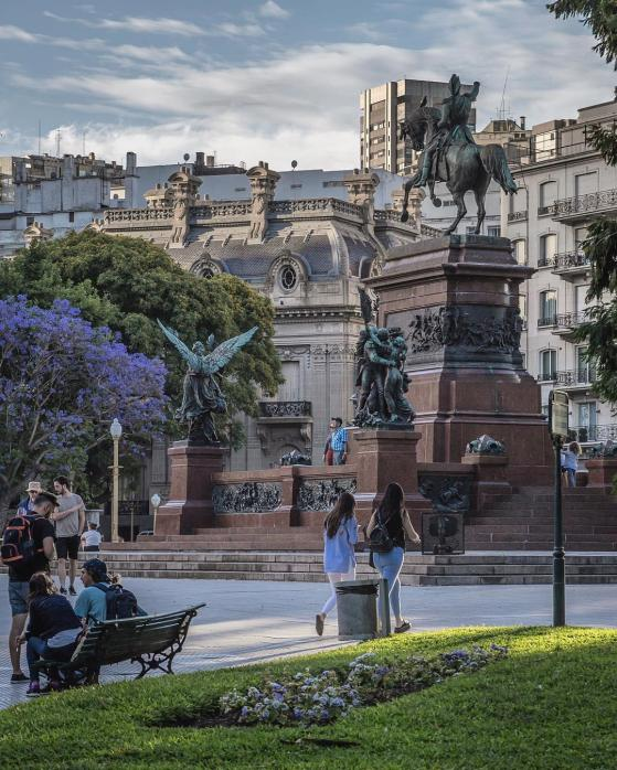 Park with purple flowers and large statue in central Buenos Aires, Argentina