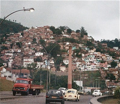 View from highway looking at favela on mountainside