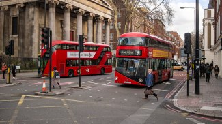 Double decker buses remain a common sight on London's streetscape.
