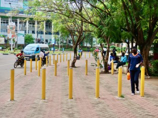 Bollards enforce pedestrian and vehicular spaces: they prevent cars from encroaching on the sidewalks.