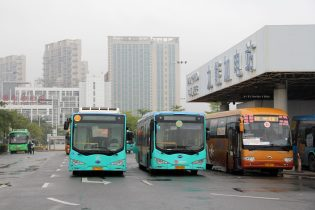 Financial incentivization through subsidies were critical to the incredible growth of electric buses in Chinese cities. Pictured, electric buses at a checkpoint in Shenzhen. The city's fleet has over 16,000 electric buses.