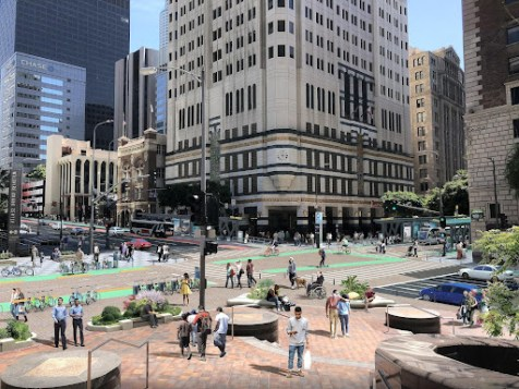 This vision of 7th Street at Figueroa in Downtown Los Angeles demonstrates a potential transit street on 7th Street, where buses, bikes, micromobility, and pedestrians are prioritized and connect at one of the largest transit hubs in Los Angeles County, the 7th/Metro station. Although Downtown Los Angeles represents only 1 percent of the city's land, it represents 15 percent of the city's transit use.